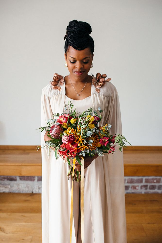 Bride in Bespoke Ailsa Monroe Jumpsuit & Cape | Bright Bouquet with Proteas | Relaxed Industrial Wedding at Ocean Studios, Plymouth | Freckle Photography