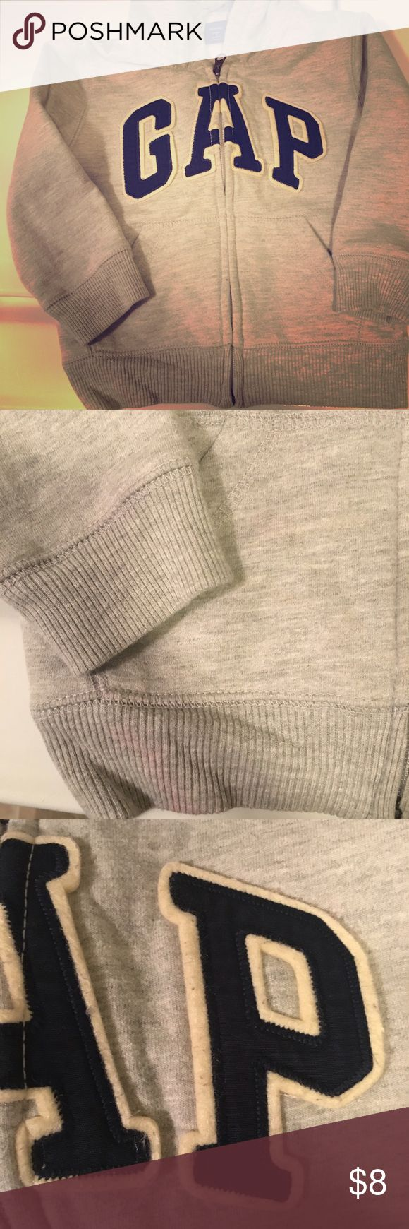 Gap 3 year old light grey zip up Has 1 red stain on bottom left on the outside and inside but not as noticeable when you wear it. The letters in GAP have some furr balls that can come off if tried. Purchased new but my son did wear it. GAP Jackets & Coats