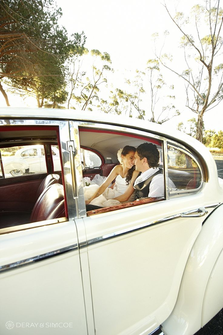 Romantic wedding photos in a classic white wedding car Location ~ Kings Park, Perth Photography by DeRay & Simcoe