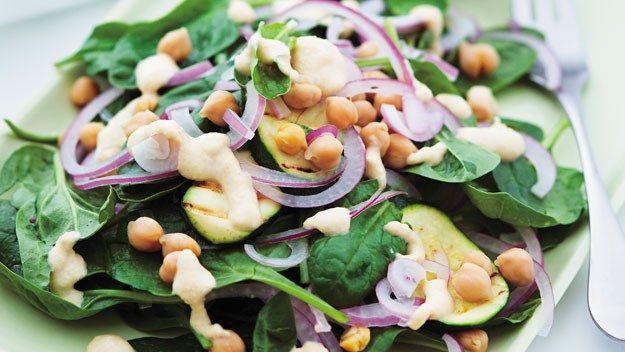 Spinach and zucchini salad with yogurt hummus