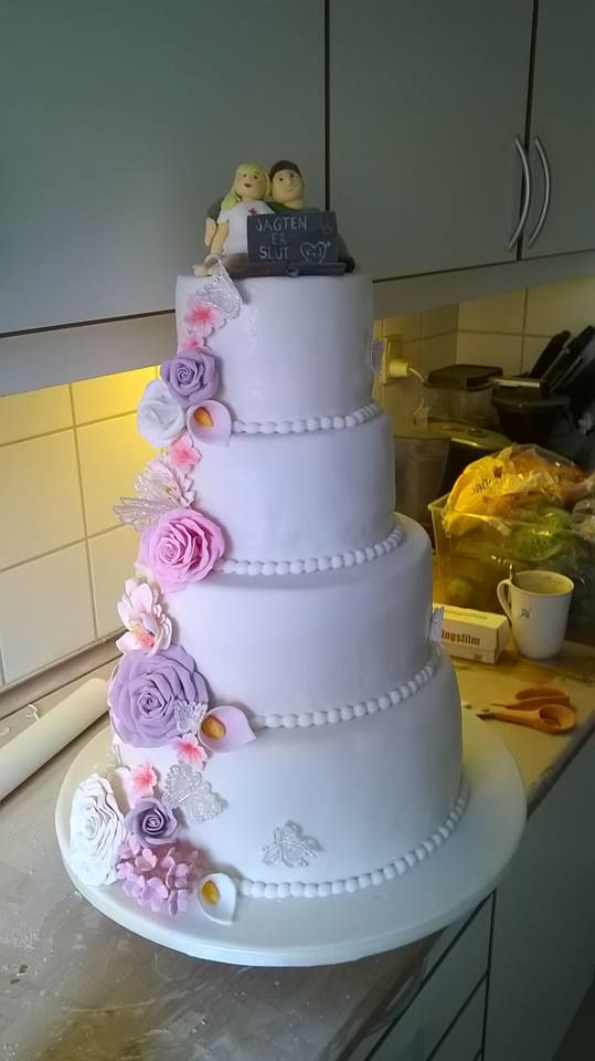 Simple yet romantic wedding cake with fondant flowers and marzipan.