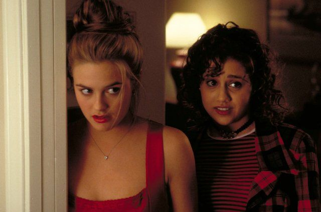 Alicia Silverstone (as Cher Horowitz) and Brittany Murphy (as Tai Frasier) Clueless (1995)