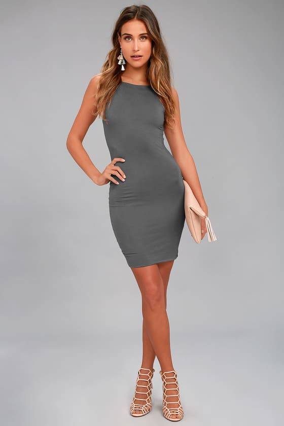 With the I Bet Charcoal Grey Bodycon Dress, we're all in! Soft jersey starts at slender straps, and falls to an apron neckline, sleeveless bodice, and bodycon silhouette. Mini hem.