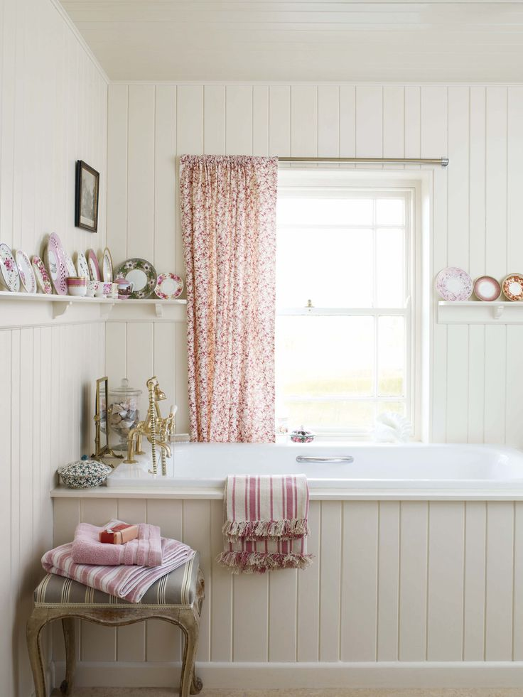 I love this - old fashioned floral curtains look so sweet with the tongue and groove bath panels! | Still You