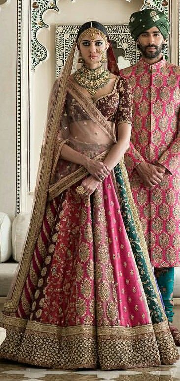 Buy this multi colored bridal lehenga inspired from sabyasachi jaipur collection(this is a replica and not the original outfit).Available on discount.
