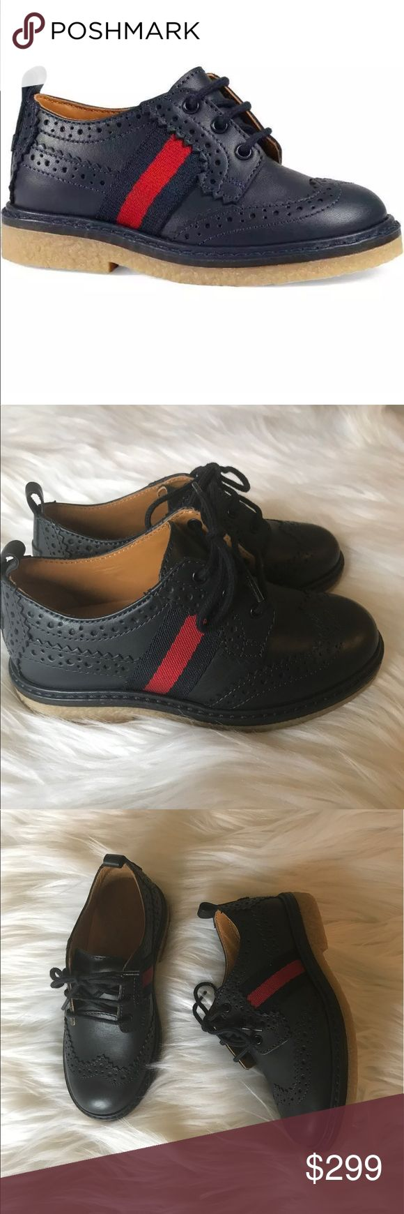 New Gucci Kids Navy Darby Oxford Shoes New Without box, Toddler Size 8US /24EU From Nordstrom's. Still Full price at Nordstrom Website.    Details & Care Wingtip brogue styling defines a handsome leather oxford set on a sturdy crepe sole and accented with a bold Gucci stripe. 	•	Lace-up style. 	•	Leather upper and lining/rubber sole. 	•	By Gucci; made in Italy. 	•	Kids' Shoes. Gucci Shoes Dress Shoes