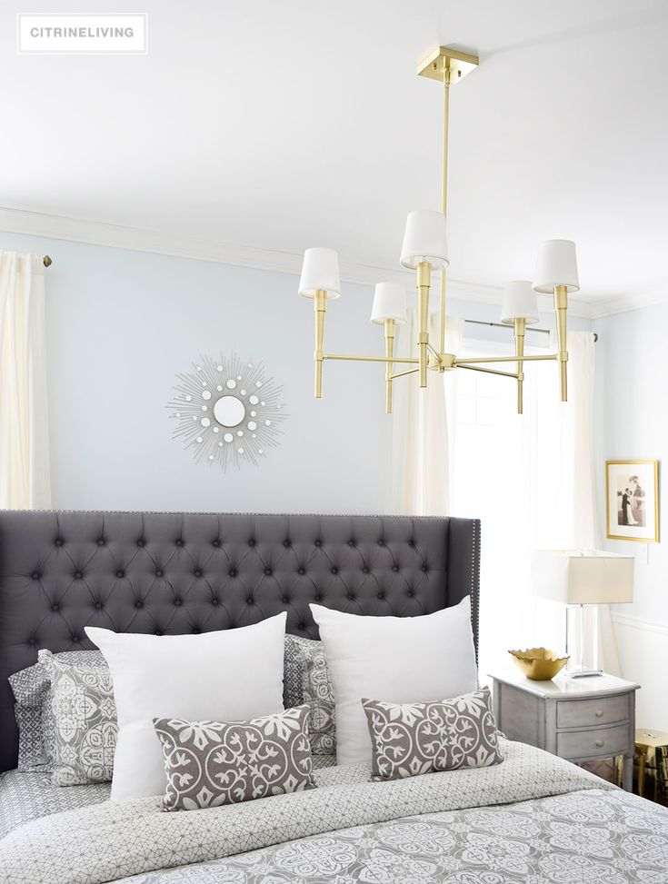 A brass chandelier and accents add modern