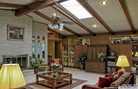 The interior of this 1970s home In San Antonio, Texas has cathedral ceilings and plenty of wood or fake wood in its interiors.