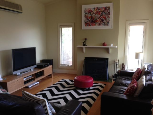 Oak Ethnicraft Entertainment Unit and Chevron Rug from Bayliss Rugs
