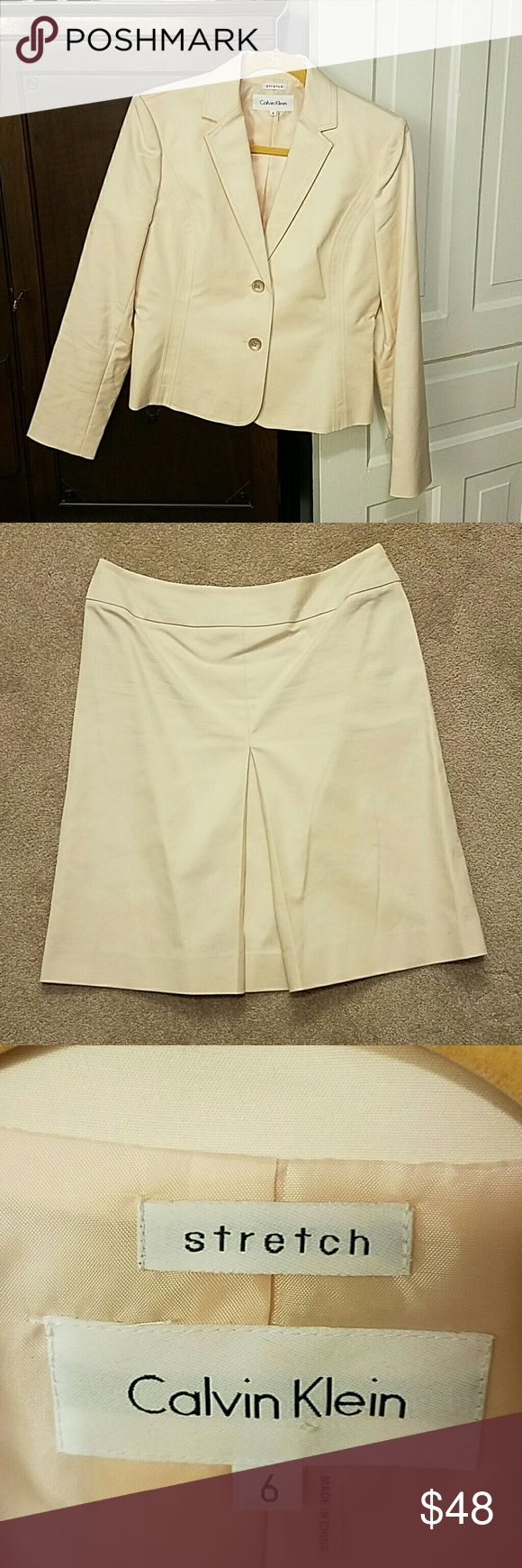 Calvin Klein Suit Great, classic cut skirt suit. Light khaki/peach undertone, V-ed accent in the front of the skirt, slight A-line cut, no slit in the back. Size 6, but fits like an 8. I'm certainly not a 6 and it fits me comfortably! Great Spring/Easter suit! Calvin Klein Other