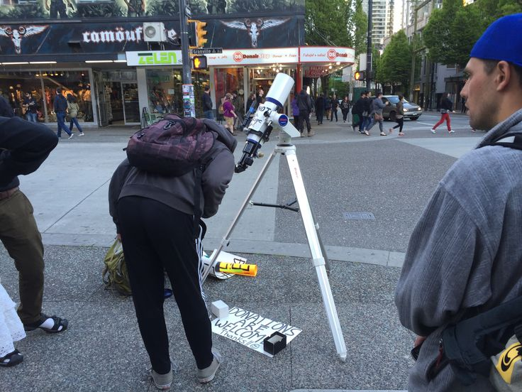 Just before the concert at The Orpheum last Saturday, I also saw this guy across the street with his telescope offering views of the Moon. :-)