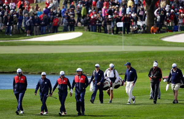 Jimmy Walker, Rickie Fowler, Zach Johnson and Phil Mickelson of the United States walk up a fairway while practicing prior to the 2016 Ryder Cup at Hazeltine National Golf Club on September 27, 2016 in Chaska, Minnesota.