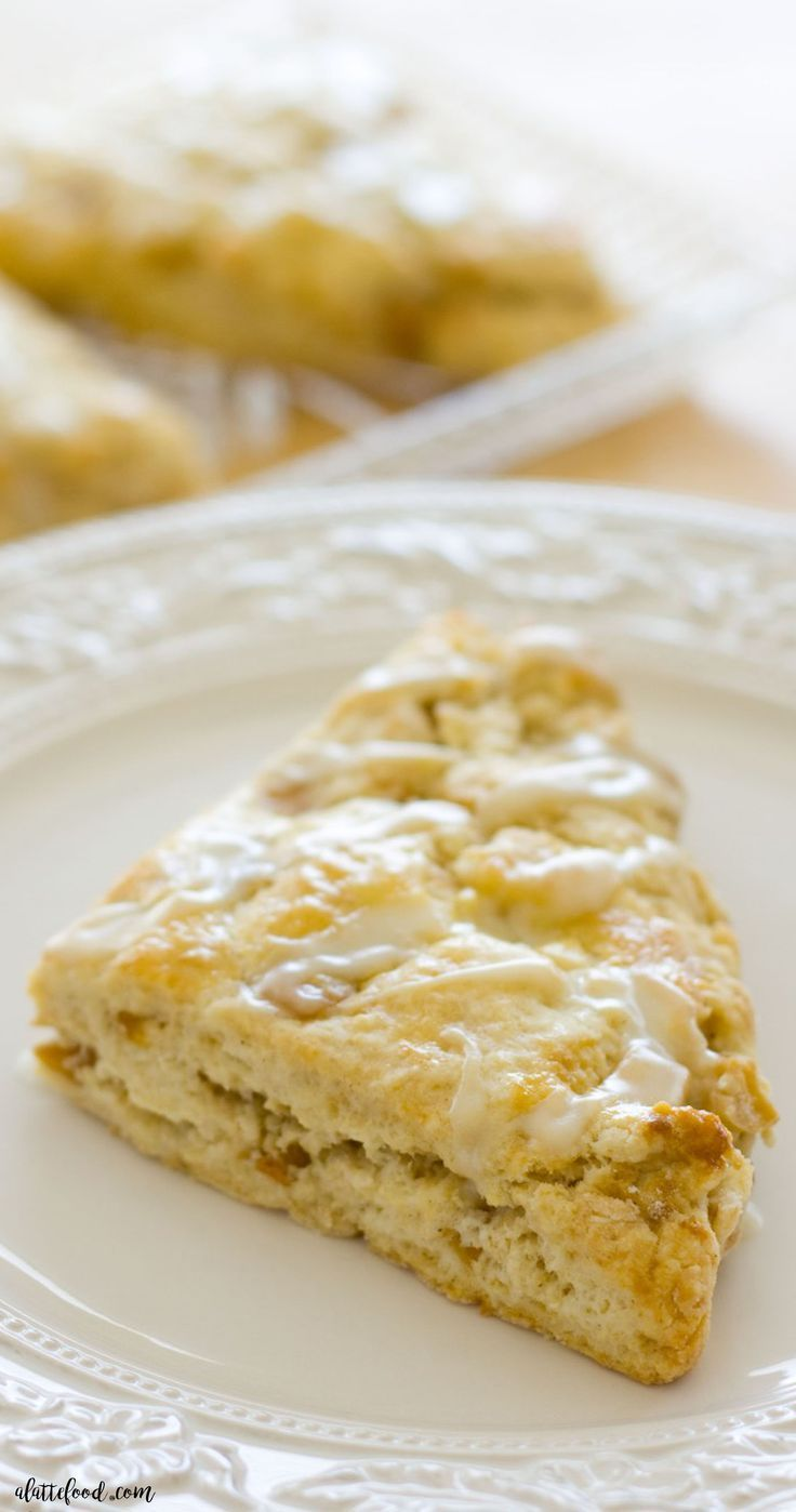 This easy apple pie scone recipe makes the lightest, flakiest scones! Filled with sweet apples and cinnamon spice, these cream scones are the perfect breakfast, brunch, or dessert!