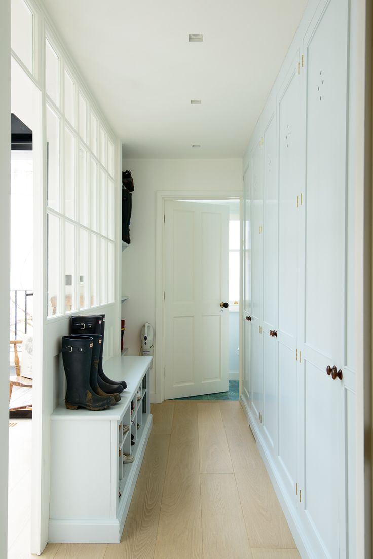 A beautiful blue boot room made using traditional techniques by deVOL Kitchens