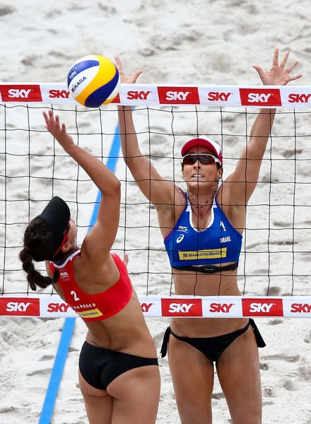 Agatha Bednarczuk (R) of Brazil blocks the ball during the Women's Finals match against Sarah Pavan and Melissa Humana-Paredes of Canada of Brazil at Olympic Park during day four of the FIVB Beach Volleyball Rio Grand Slam, on May 21, 2017 in Rio de Janeiro, Brazil.
