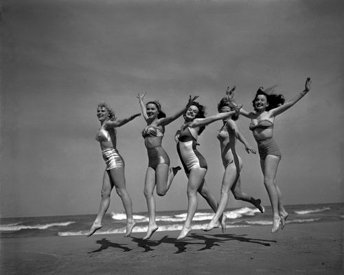 Frolicking on Oak Street Beach, Chicago, 1950.