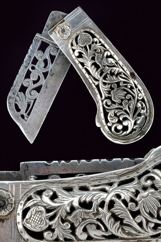 A silver mounted folding knife   provenance:Asia dating:19th Century