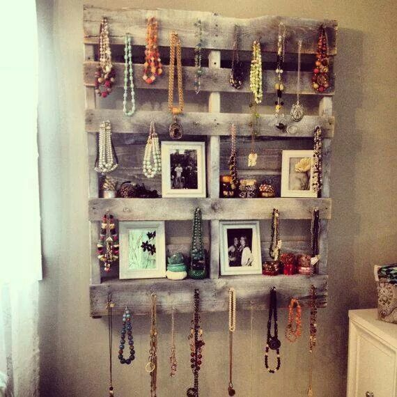 Love this idea for hanging jewelry and pictures on an old pallet. Southern recycling at it's finest.