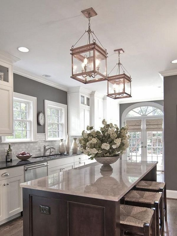 grey walls, white cabinets, chrome fittings,grey countertop....rose gold lanterns over walnut island by Boglárka