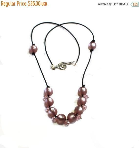 On Sale Pink Beaded Necklace on a  leather cord featuring pink