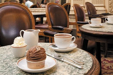 """Belle Epoque-inspired Angelina favored among Marcel Proust and Coco Chanel. Rue de Rivoli, one of the most exquisite places to go in Paris for a hot chocolate. best-selling version is the Old-Fashioned Hot Chocolate """"L'Africain."""" 4 different cocoa beans from Africa, why it's also served with a bowl of unsweetened whipped cream to temper its potency. also order Angelina's other signature menu item, the Mont Blanc pastry — meringue shell, filled w/ chestnut puree + topped w whipped cream."""