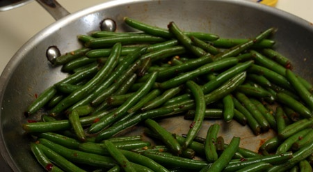 Speed saute frozen green beans. Heat oil, toss in the FROZEN beans, toss until thawed, then add seasonings. I used garlic red pepper and Parmesan for a quick side for chicken.