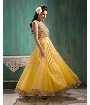 Pretty Georgette Ethnic Suit $44.Bring elegance in your festivities with the Pretty Georgette Ethnic Suit that showcases the vibrancy of sunny hues. Crafted in georgette, the kameez is in a lovely shade of yellow, which is perfectly complemented by the fine gold embroidery on the bodice and a gold lace border.