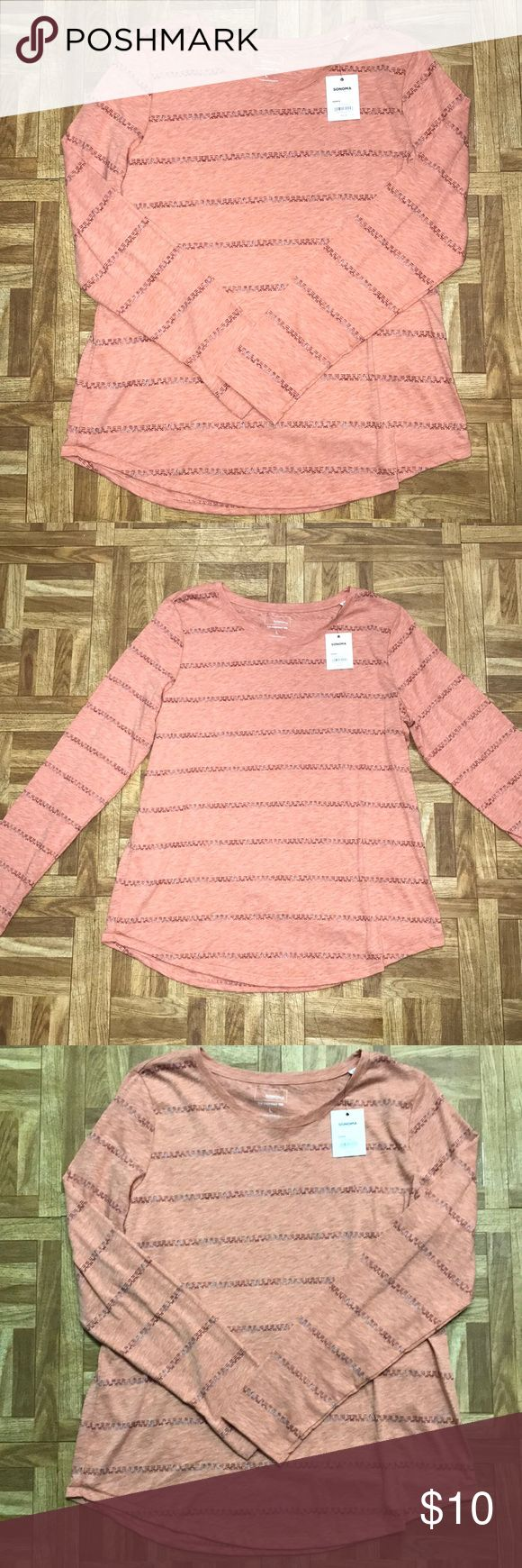 NWT Sonoma long sleeve tee NWT. Sonoma tee shirt. From kohls. Size large. Scoop neck, curved hem. Very pretty coral / pink color. Has purple and silver sparkly patterned striped across shirt. Looks very boho and earthy. Can be dressed up or down. Smoke free home. Sonoma Tops Tees - Long Sleeve