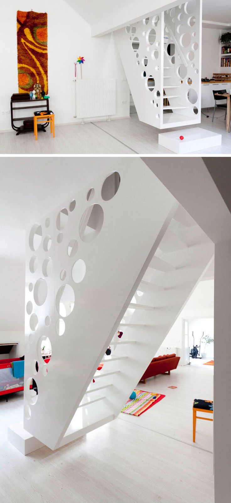 This playful, white, hanging staircase has circular cutouts on both sides to add an element of safety to the stairs and make the space feel more open and connected.