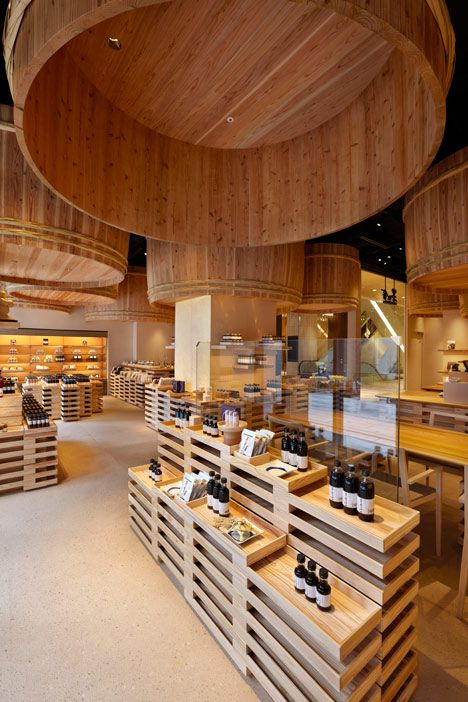 Kengo Kuma suspends wooden barrels over Japanese soy-sauce shop.