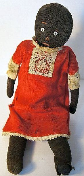 Antique black stockinette doll with a sweet sad face.