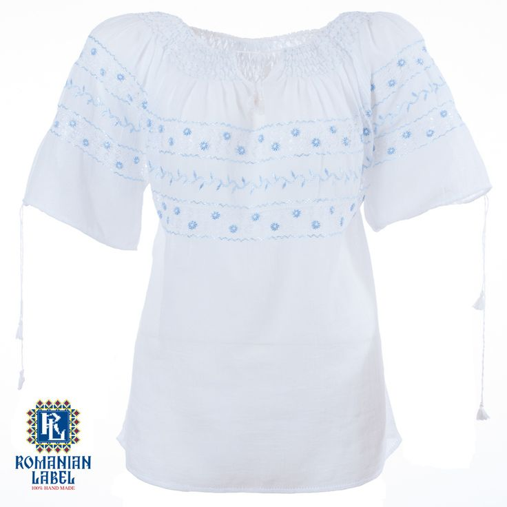 $84.20 A 100% hand made traditional blouse, exclusively tailored out of natural materials, such as white cotton and blue silk embroidery.