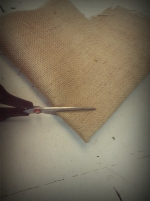 Step 5) wrapping - fold the hessian wrap in half again and cut the pointed corner off as shown