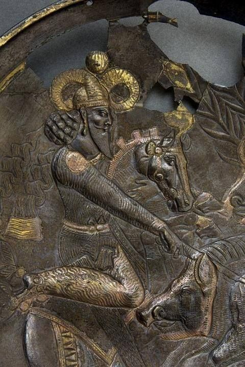 Silver plate (partially gilded) with the Sasanian king hunting wild boar. 4th century CE. Hermitage Museum