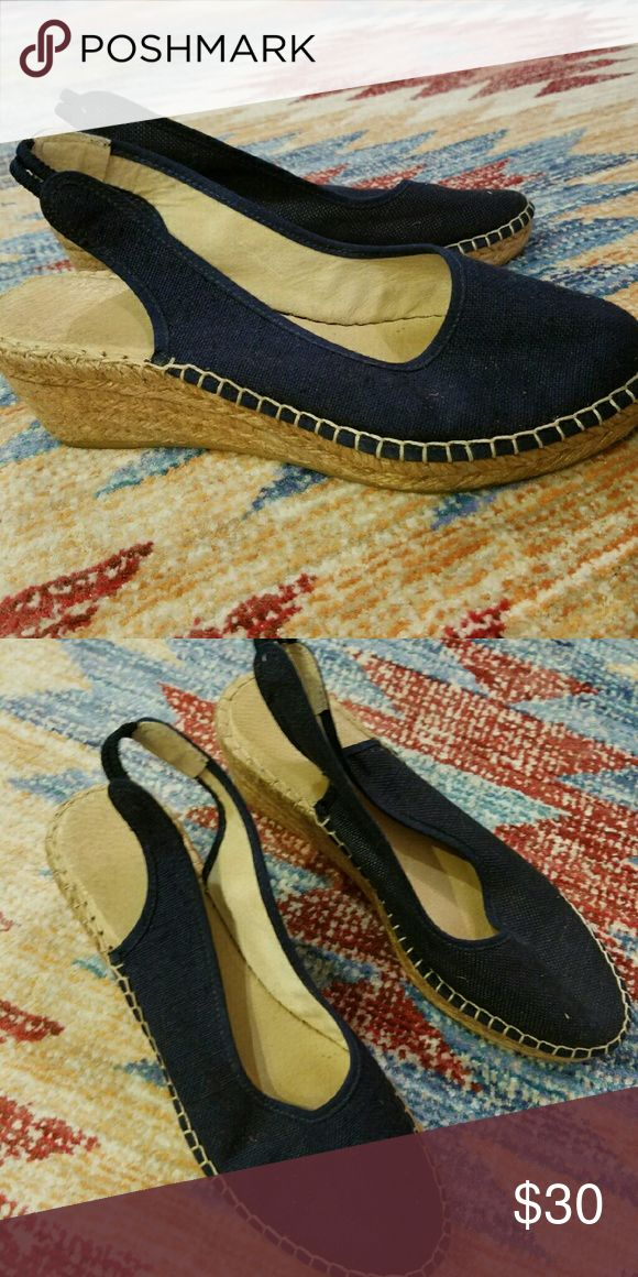 Navy blue espadrilles hand made from Spain Bought in Madrid Spain but only worn twice. Fits a size 8. Navy blue, handmade, wedge is about 2.5 inches. Shoes Espadrilles