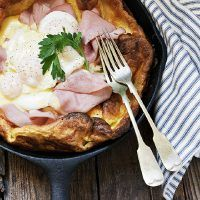 Eggs Benedict Dutch Baby - Seasons and Suppers