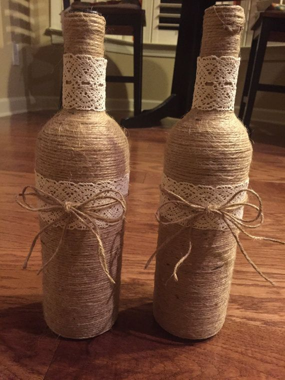 Set of 4 twine wrapped wine bottles with lace and twine bow! These are the perfect edition to add the finishing touch to your wedding decor! Please feel free to contact us about discount pricing on large orders