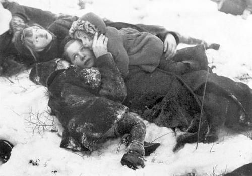 Finnish civilians dive to the ground as sirens warn about approaching Soviet bombers. Apparently there's no air raid shelter anywhere nearby. Winter War, 1940.