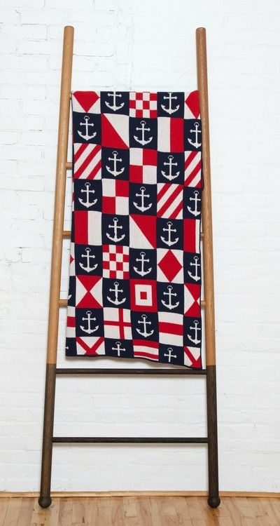 We love our new Checkmate Luxury Throw from In2Green featuring checkered anchors, diamonds, and signal flag.
