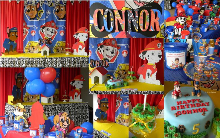 Paw Patrol party with themed backdrop and paw print table skirt