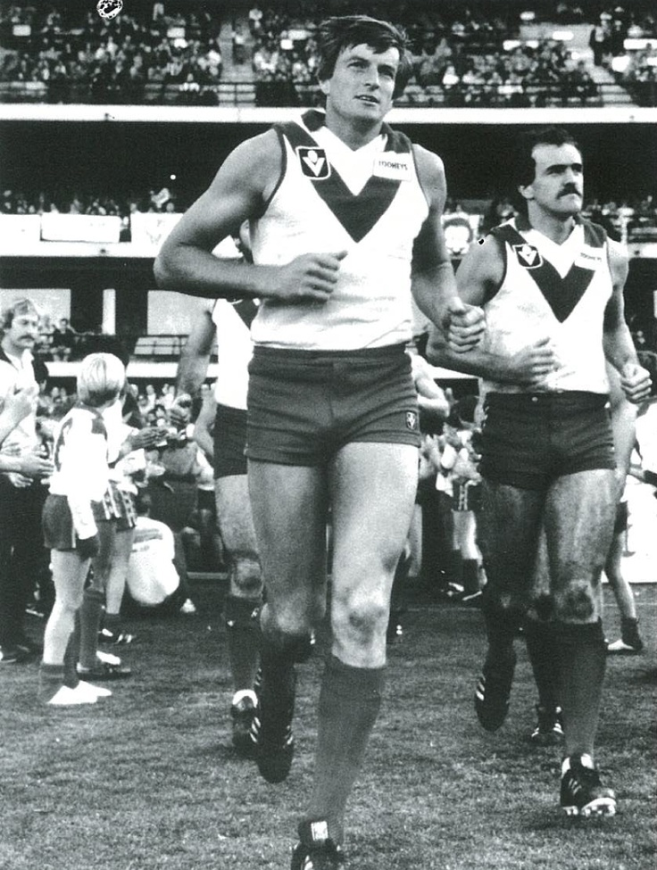 #1 - The first 'home' game in Sydney, 1982  Swans captain Barry Round leads the team out for the club's first home game on the SCG
