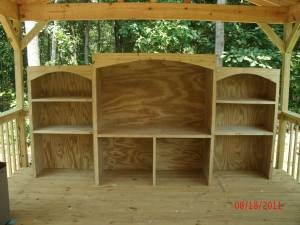 """Outdoor """"entertainment"""" shelving unit  Made out of pressure treated plywood/lumber"""