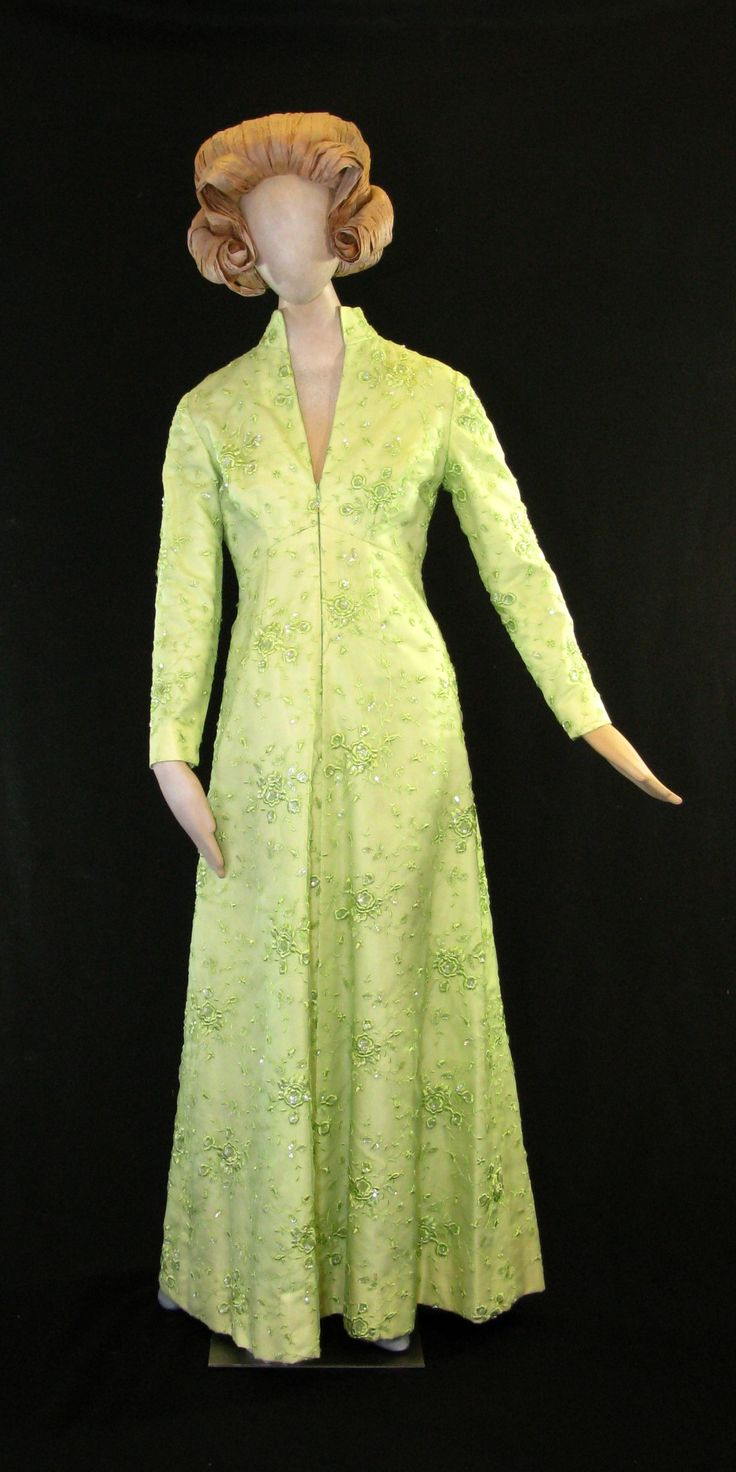 The green, satin chiffon gown with embroidery and sequins designed by Frankie Welch for First Lady Betty Bloomer Ford, worn for the state dinner of the Shah of Iran, the Emperor's Dinner at the Japanese Embassy and the state dinner welcoming the King and Queen of Spain. 1975-1976.