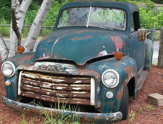 Old Rusted And Falling Apart Car