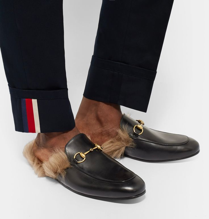<a href='http://www.mrporter.com/mens/Designers/Gucci'>Gucci</a>'s 'Princetown' loafers are perhaps most emblematic of the Italian label's bold new chapter - they were introduced during Creative Director Mr Alessandro Michele's debut collection in 2015. Expertly crafted from timeless black leather and detailed with iconic gold horsebits, they're lined in soft shearling for optimum comfort and character. Show them off with tapered trousers.