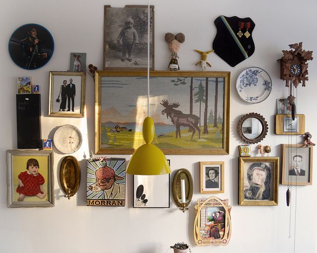 Camilla Engman's kitchen wall - Sweden. Complete with cuckoo clock, moose, and shield.