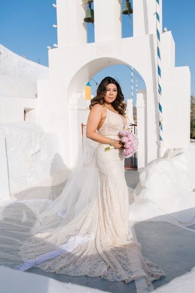Our stunning bride!!! #gown #dantele #veil #pink #bouquet #wedding #planner #ideas # church #santorini #Greece #cyclades