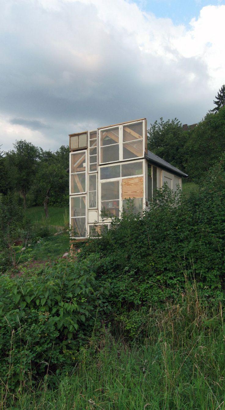 tiny-garden-house-3: Tiny House, Recycled Window, House Windows, Operation Greenhouse, Tiny Garden House, Log Houses, Salvaged Greenhouse, Garden Houses, Glass Houses