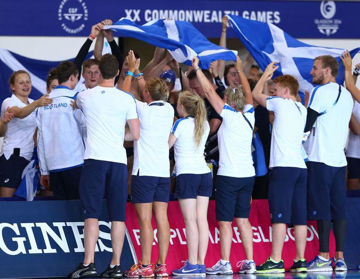 Gold medallist Ross Murdoch of Scotland walks through a guard of honour after the Men's 200m Breaststroke Final