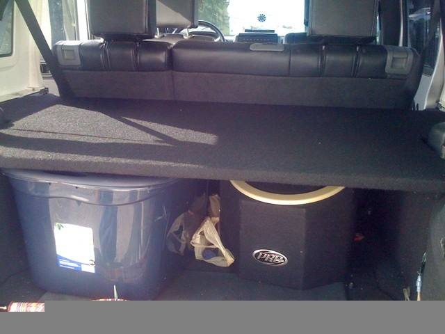 Jeep JK Unlimited rear cargo shelf DIY  —  A cool solution for those looking to get more organized storage.